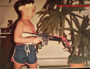 Circa 1985 Kevin playing like Rambo with a toy M16. Note the sling made from his father's robe belt.