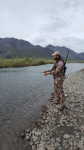 Fishing in Alaska with a rifle